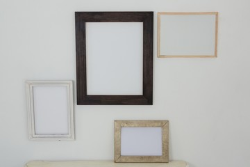 Frames hanging on wall