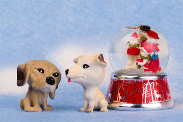 Two dogs and a snow globe.