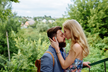 Young couple in love outdoor.Stunning sensual outdoor portrait of young stylish fashion couple posing in summer