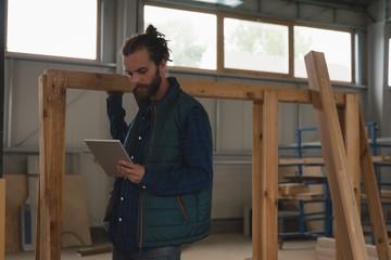 Carpenter using digital tablet