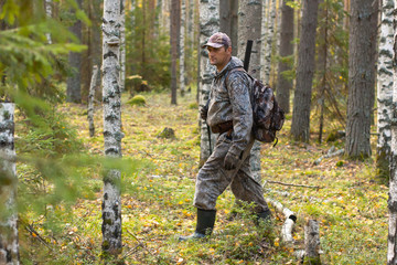 hunter walking through the forest