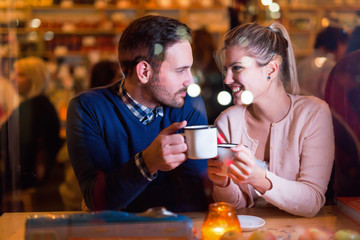 Young attractive couple on date in bar