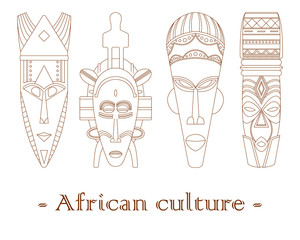 Set of four traditional African masks on a white background.