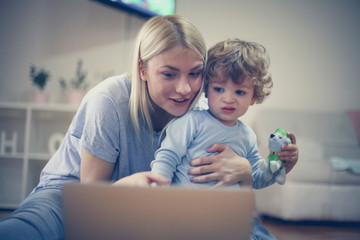 Mommy and me watch cartoons on laptop. Little boy.