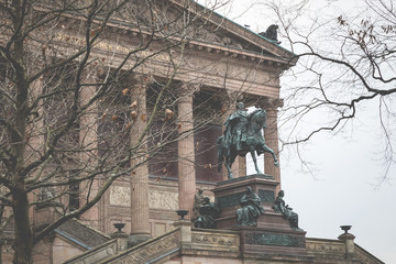 Exterior view of Alte Nationalgalerie (Old National Gallery) on the Museumsinsel in Berlin-Mitte. The Pergamon museum on the left in the background.