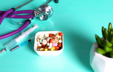 Medicine pills, tablets and capsules on table