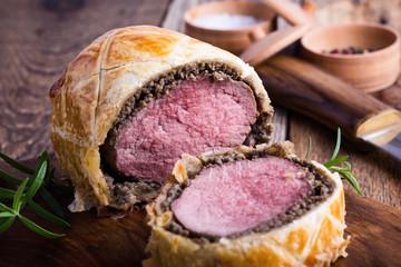 Beef Wellington, classic steak dish on cutting board