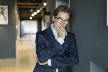 Portrait of businessman wearing glasses in office