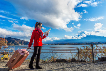 Wall Mural - Tourist with baggage and map at Fuji mountain, Kawaguchiko in Japan.