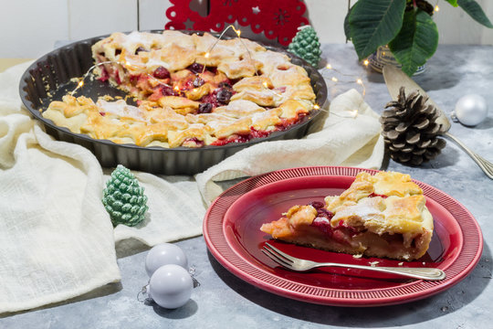 Apple cranberry pie. White and red background. Christmas decoration.