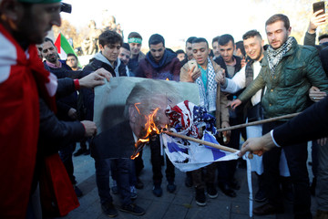 Demonstrators burn U.S. President Donald Trump's picture and Israeli flag during a protest against U.S. President Donald Trump's recognition of Jerusalem as Israel's capital, in Istanbul