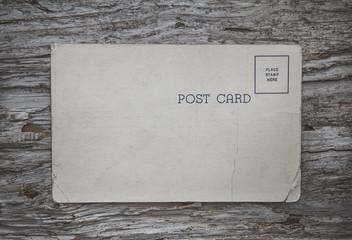 Vintage postcard on the old wood