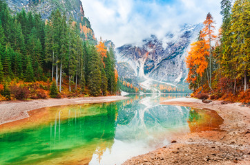 Lake Braies iconic natural landmark in Italy, South Tyrol Dolomites alpine region. Beautiful autumn scenery of captivating incredible Lake Braies in italian Dolomite Alps mountains. Forest on banks. Wall mural