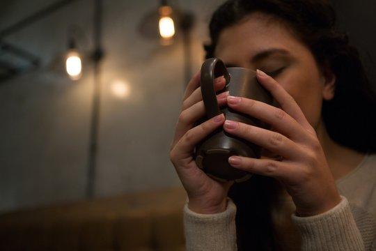 Beautiful woman having coffee