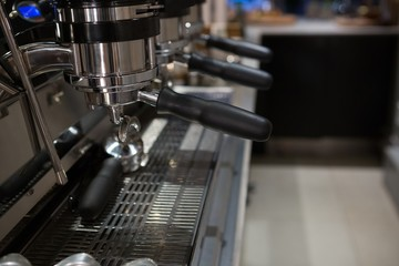 Empty espresso machine at counter
