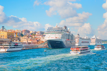 Luxury cruise ship in Bosporus against galata tower, Istanbul