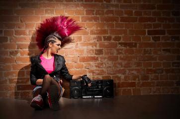 Punk girl on brick wall background