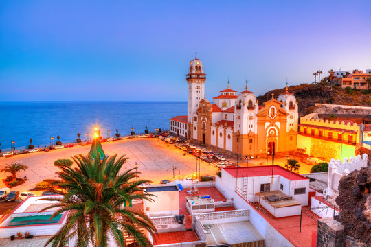 Panoramic view of  Santa Cruz catholic church illuminated in evening, in Christmas holiday, Tenerife, Spain