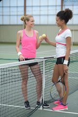 female tennis players on indoor court