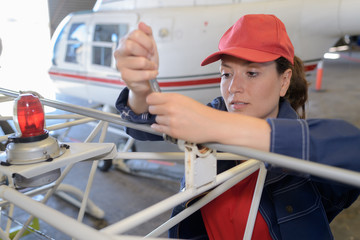 female helicopter mechanic working