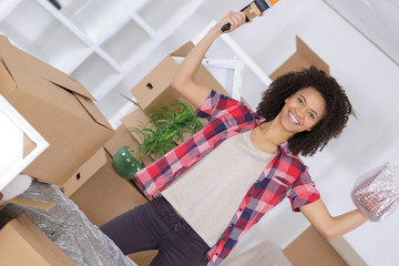 happy young woman packing