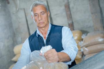 farmer packing grain