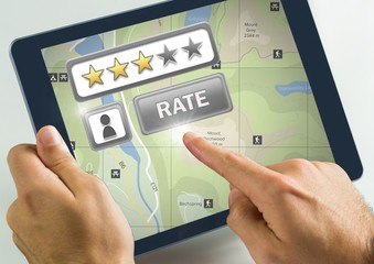 Hand touching tablet with Rate button and review stars with map