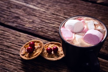 Cookies and hot chocolate on wooden plank