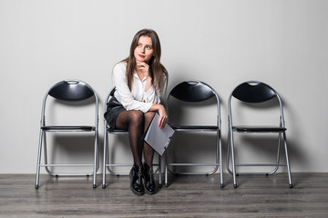 Young woman waiting for job interview in office hall