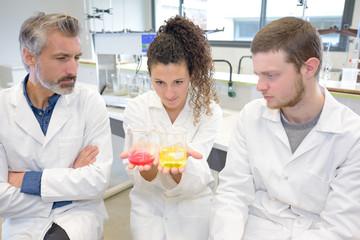 scientific laboratory researchers perform tests with liquids