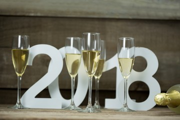 Champagne glasses surrounded against numbers forming 2018 year