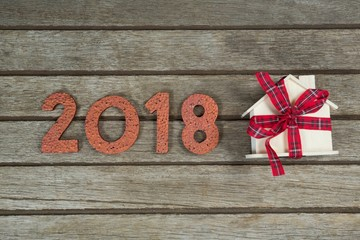 New year 2018 with gift on wooden surface