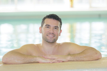handsome sexy man in the swimming pool