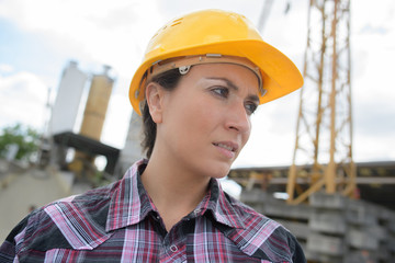 beautiful female architect at a construction site