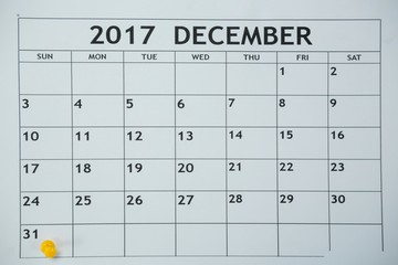 Yellow pin push on day 31st of month end on white calendar
