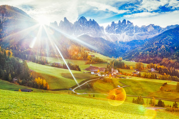 Wall Mural - Italy, South Tyrol. UNESCO world heritage list area.  Incredible landscape of Funes Odle in Dolomite Alps. Epic Sunrise scenery over meadows of Santa Maddalena - Magdalena alpine village and mountains