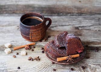 chocolate cupcake with strawberries and coffee mug