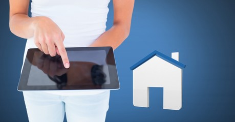 Hand touching tablet with 3D house icon