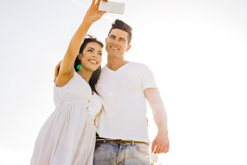 Beautiful  young couple taking a selfie on a summer day