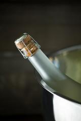 Champagne bottle in a silver ice bucket