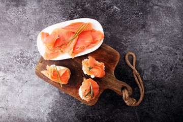 Bread with smoked salmon and cream cheese and herbs.