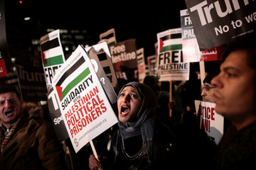 Protesters demonstrate outside the U.S. embassy against President Donald Trump's decision to recognise Jerusalem as Israel's capital, in London