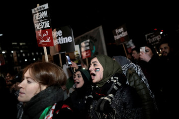 Protesters demonstrate against President Donald Trump's decision to recognise Jerusalem as Israel's capital outside the U.S. embassy in London