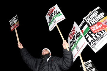 Protesters demonstrate against President Donald Trump's decision to recognise Jerusalem as Israel's capital outside the U.S. embassy