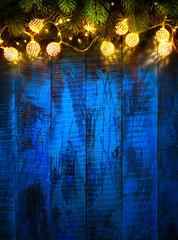 String Light Hanging At Vintage Blue Wooden Background