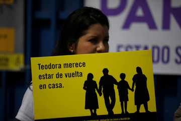 A woman protests in support of Teodora del Carmen Vasquez outside the Isidro Menendez Courthouse during a sentence review hearing in San Salvador