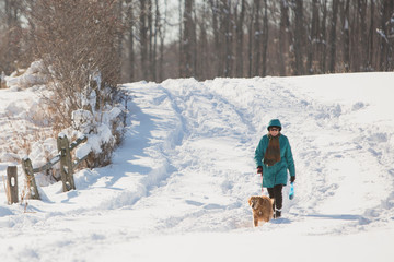A woman and a dog enjoy snow after the first lake-effect snowfall of the season at Knox Farm State Park in the Buffalo suburb of East Aurora