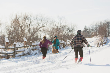 People greet each other while enjoying the snow after the first lake-effect snowfall of the season at Knox Farm State Park in the Buffalo suburb of East Aurora