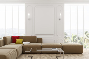 White living room, beige sofa and poster