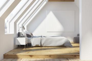 White attic bedroom, wooden floor, poster